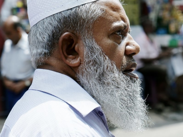 Muslim outside Red Mosque, Colombo, Srilanka