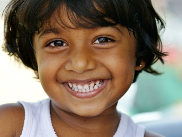 Adorable girl from fish market at Indian Ocean, Negombo, Srilanka