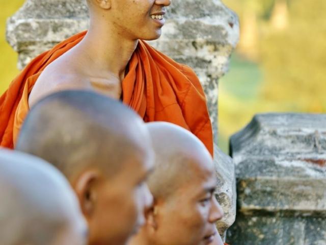 Monks on pagoda Shwesandow in sunset, Old Bagan, Burma (Myanmar)