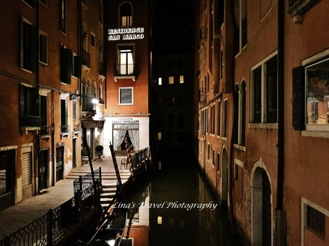 Waterway in the night, Venice, Italy