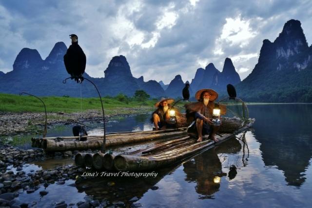 Cormorant fishermen in sunset at Li River, Yangshuo, China