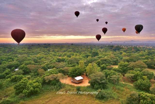 Ballooning in sunrise over about 2000 Buddhistic temples, pagodas and stupas in ruins, Old Bagan, Bagan, Nyaung U, Burma