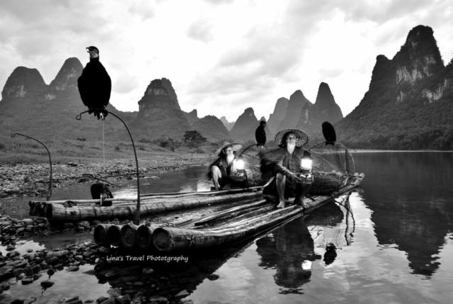 Cormorant fishermen in sunset at Li River, Yangshuo, Guangxi, China
