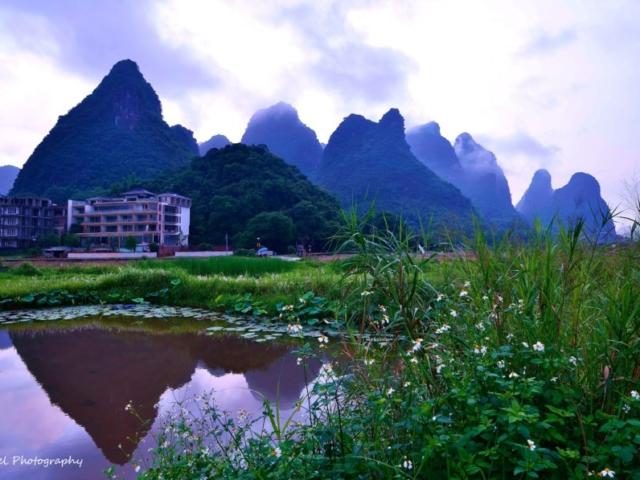 Karst landscape in reflection around Yulong River, Yangshuo, Guangxi, China