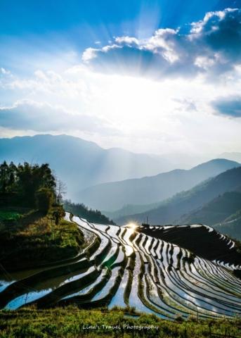 Magical light from sunset at Yiwanshui (one bowl water) Rice Terracces, Yuanyang, Yunnan, China