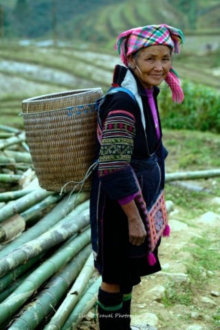 Beautiful, wam and friendly smile from Hmong ethnic woman (black Hmong group), Sapa, Lao Cai, Vietnam