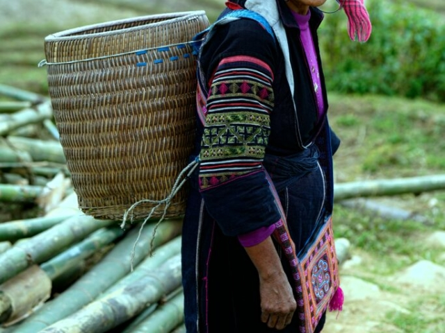Beautiful, wam and friendly smile from Hmong ethnic woman (black Hmong group), Sapa, Lao Cai, Vietnam