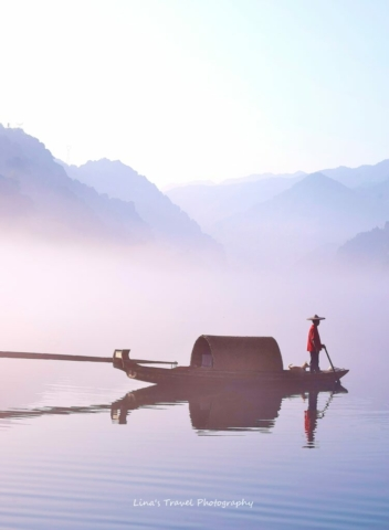 Dreamlike fishing a misty morning at East Lake, Dongjiang County, Zixing, Chenzhou, Hunan, China