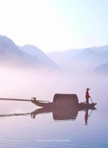 Dreamlike fishing a misty morning at East Lake, Dongjiang County, Zixing, Chenzhou, Hunan, China