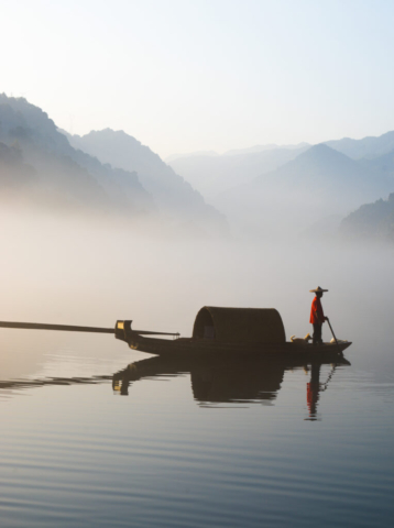Fisherman and dog, East Lake, Zixing, Chenzhou, Hunan, China
